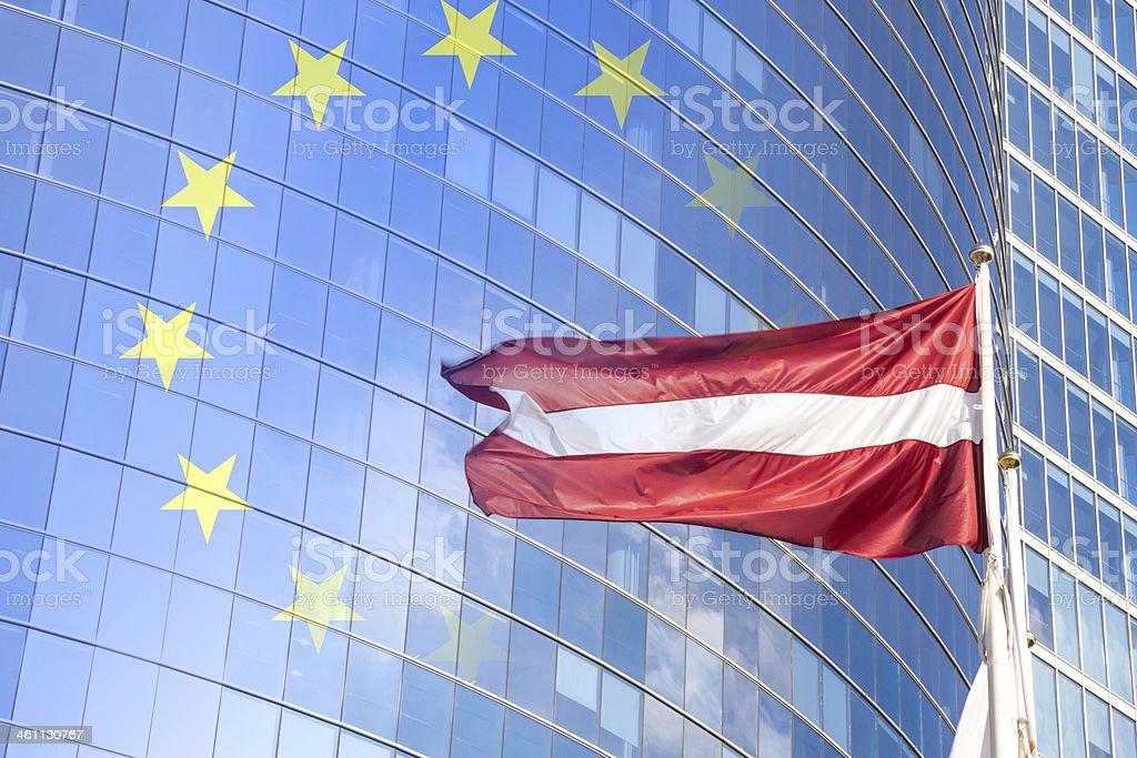 Latvia flag against glass skyscraper stock photo