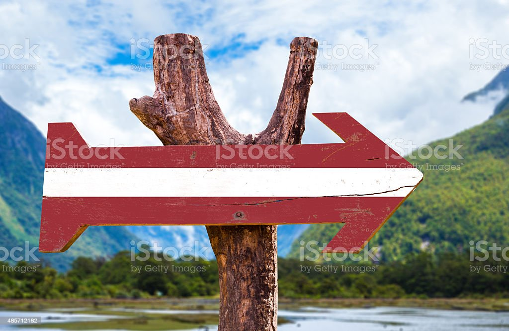 Latvia Flag wooden sign with landscape background stock photo