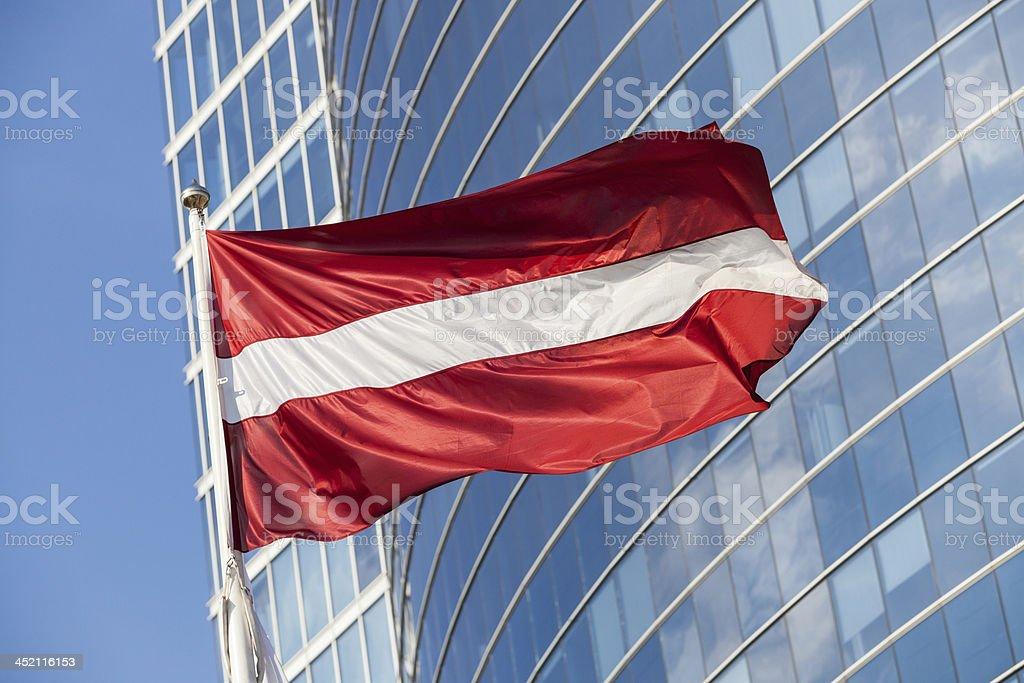 Latvian Flag against Skyscraper in Riga stock photo