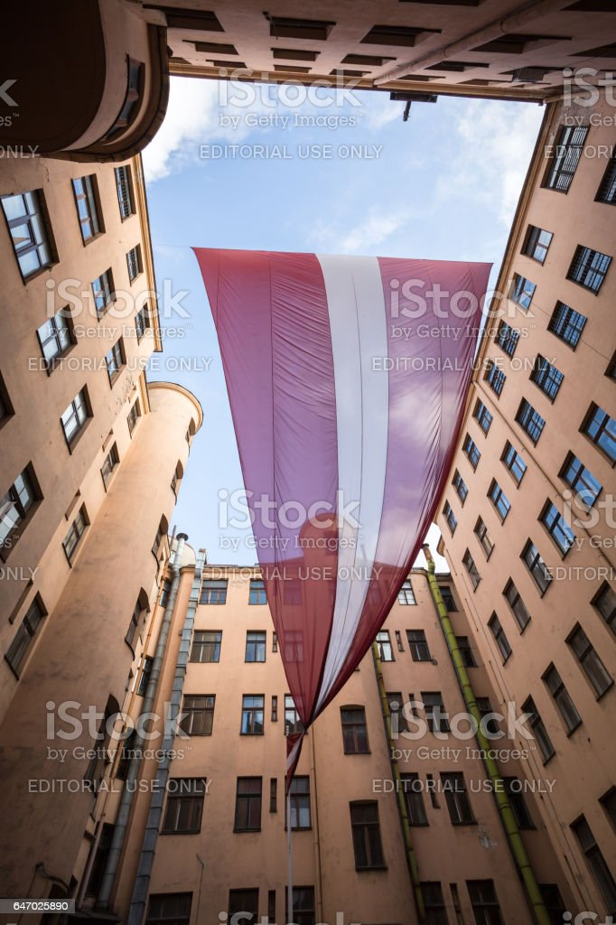 Latvian flag in the Corner House yard stock photo