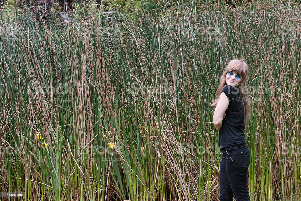 Latvian outdoor girl profile with reeds background sunglasses stock photo