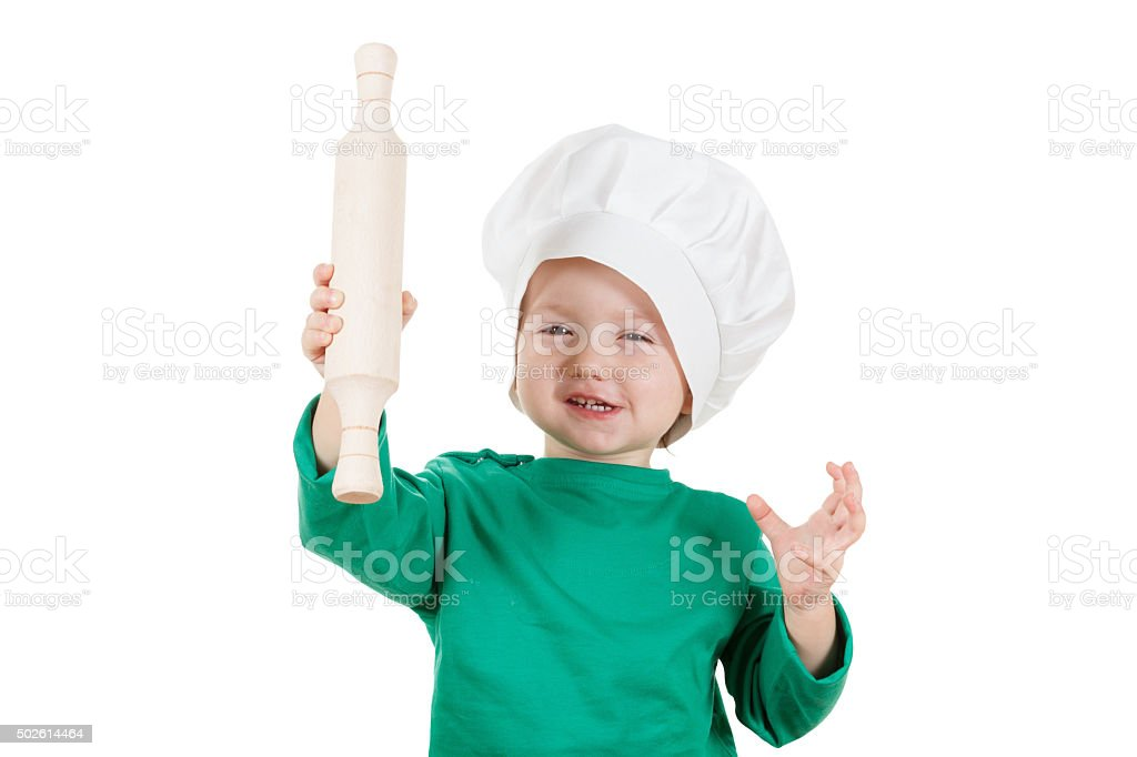 laughable little boy kneading dough cookies, isolated on white stock photo