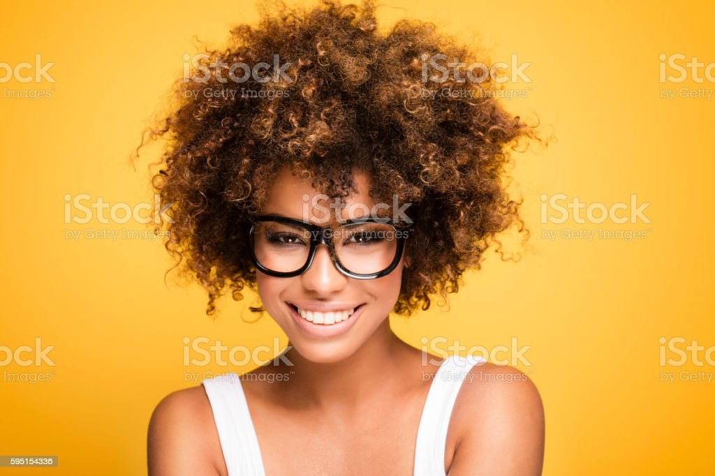 Laughing african american girl with afro. stock photo