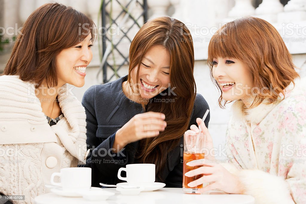 Laughing and joking women in street cafe royalty-free stock photo