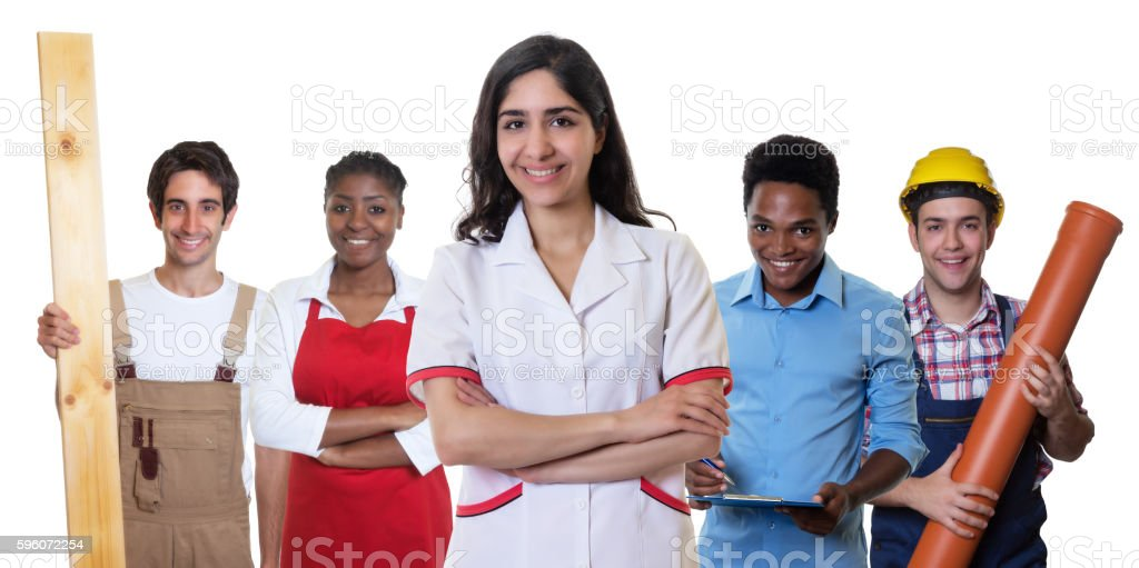 Laughing arabic pharmacist with group of other international apprentices stock photo
