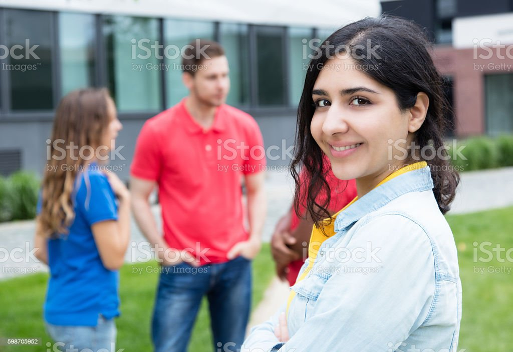 Laughing arabic woman and multiethnic friends stock photo