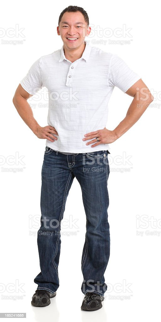 Laughing Asian Man With Hands On Hips stock photo