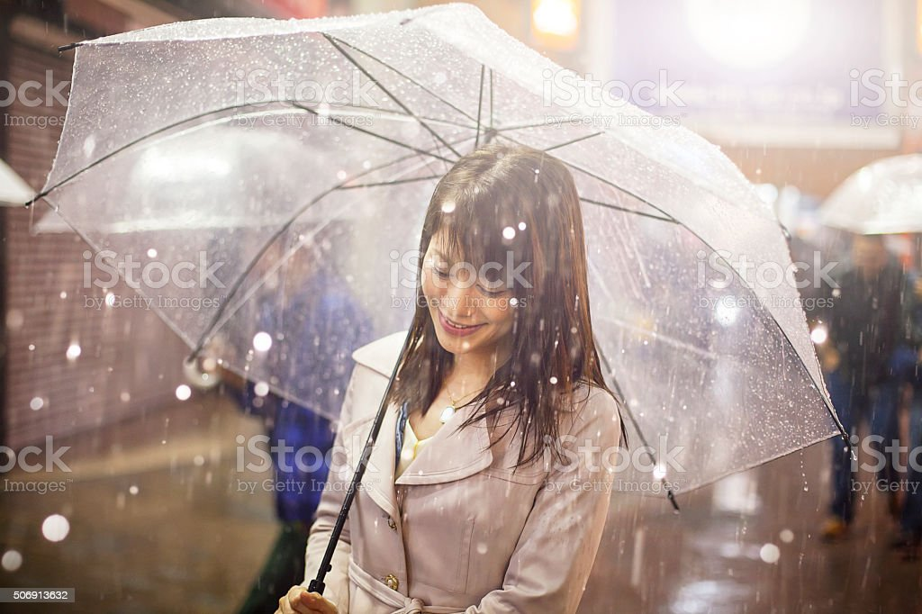 Laughing asian woman with umbrella stock photo