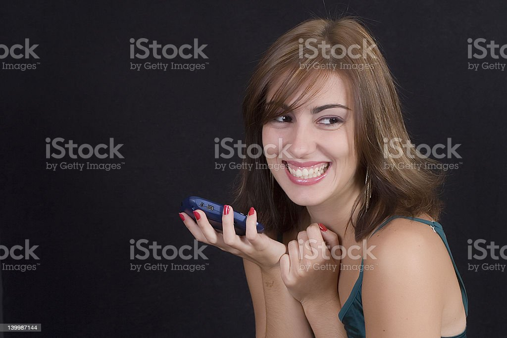 Laughing at a text message royalty-free stock photo
