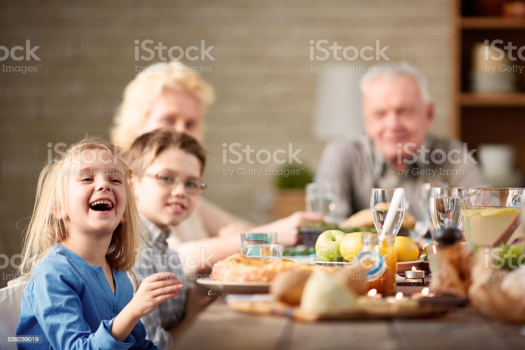Laughing at dinner stock photo