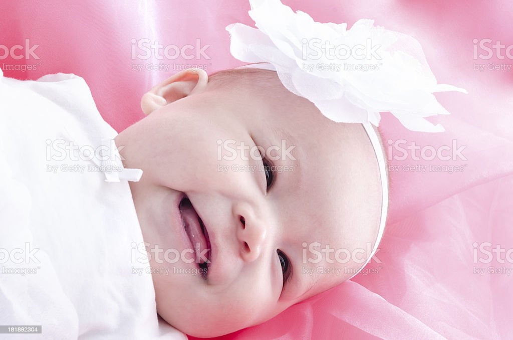 Laughing baby girl looking away. royalty-free stock photo