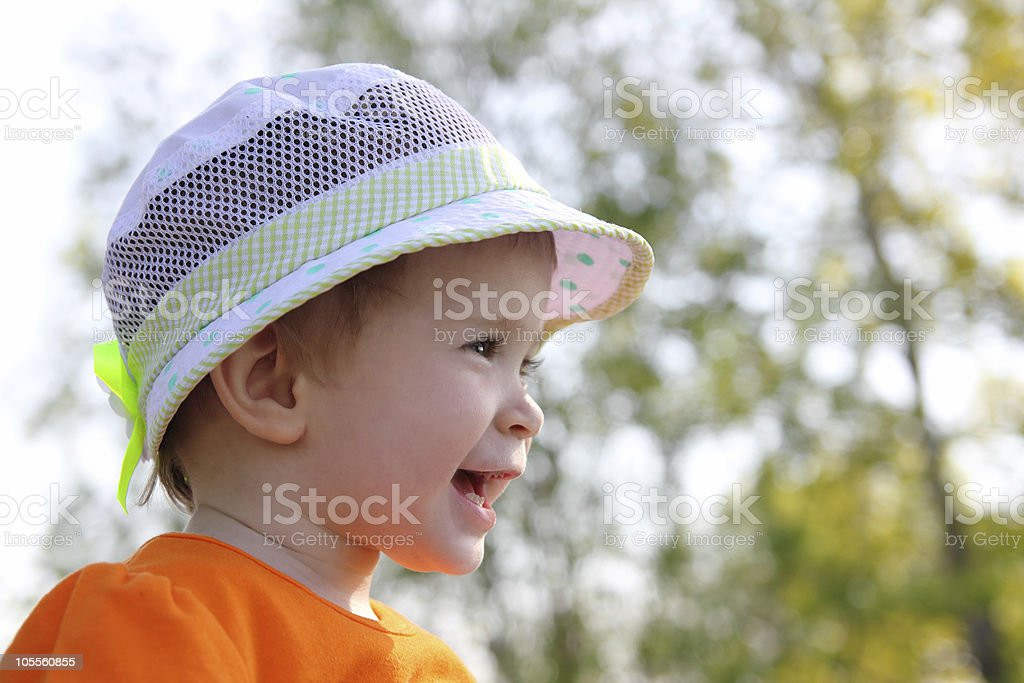 laughing baby in hat outdoor royalty-free stock photo
