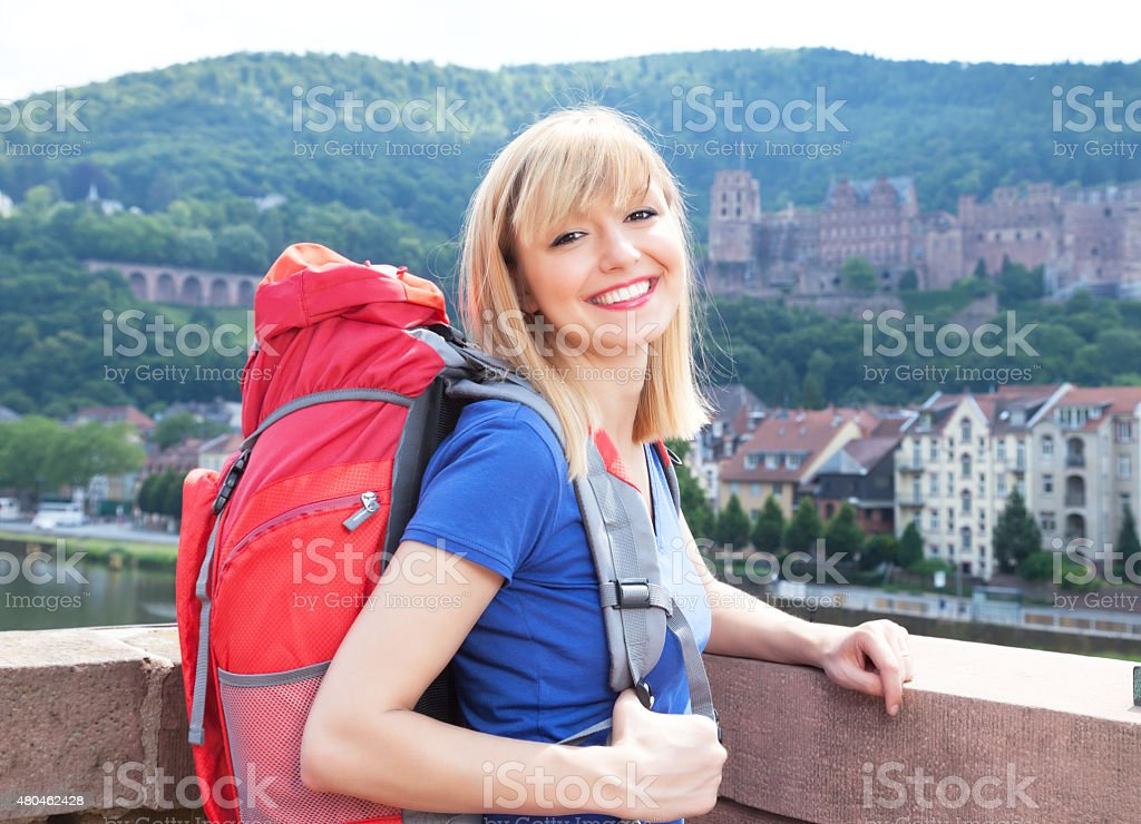 Laughing backpacker with blonde hair in Heidelberg stock photo