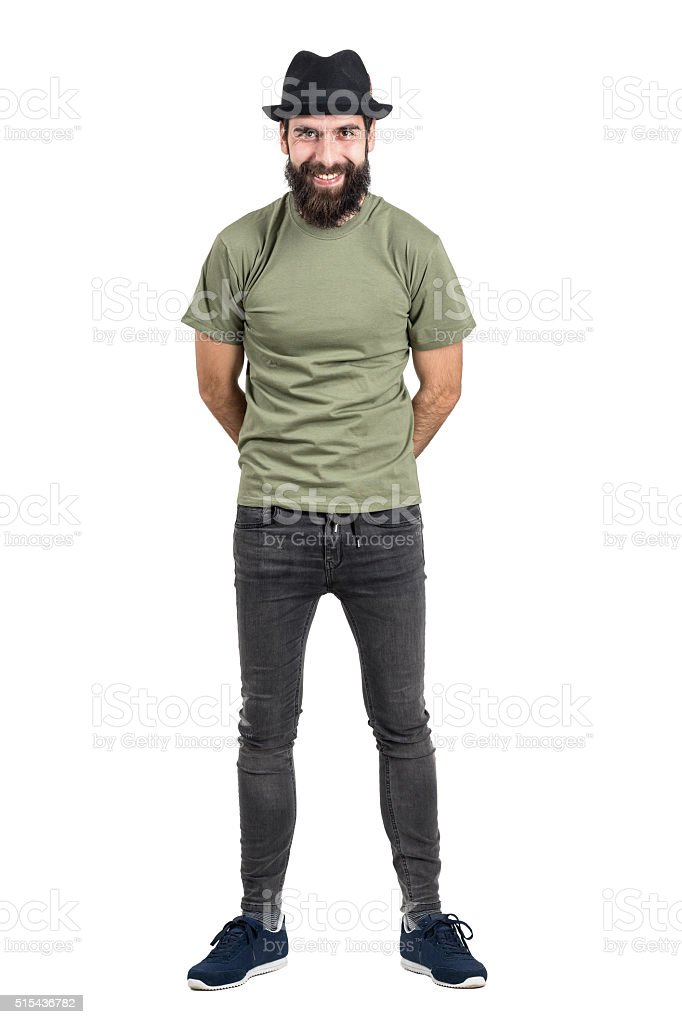 Laughing bearded man with hat looking at camera. stock photo