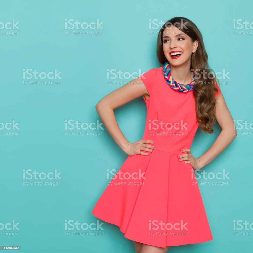 Laughing Beautiful Woman In Pink Mini Dress Looking Away stock photo