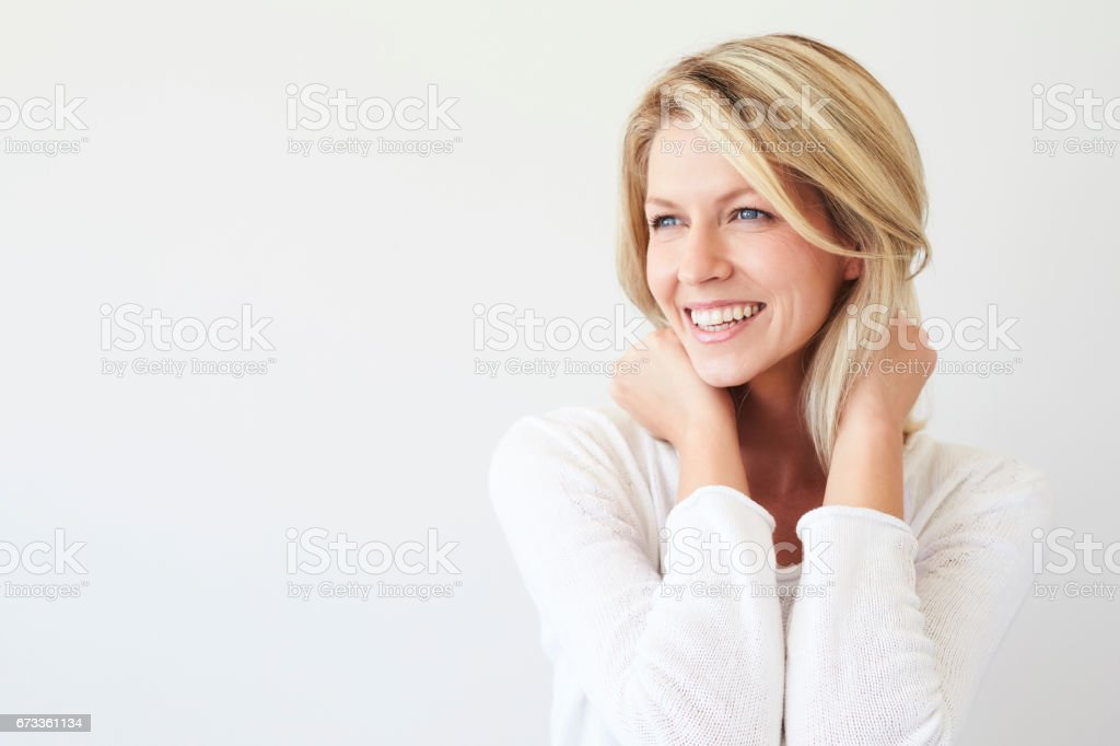 Laughing blond babe stock photo