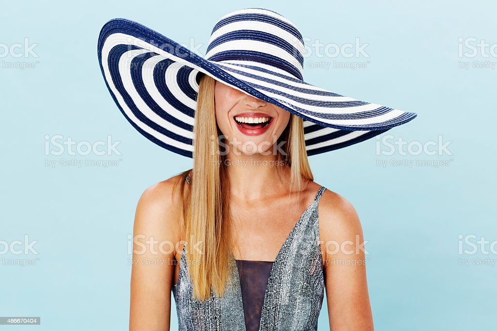 Laughing blond in summer hat stock photo