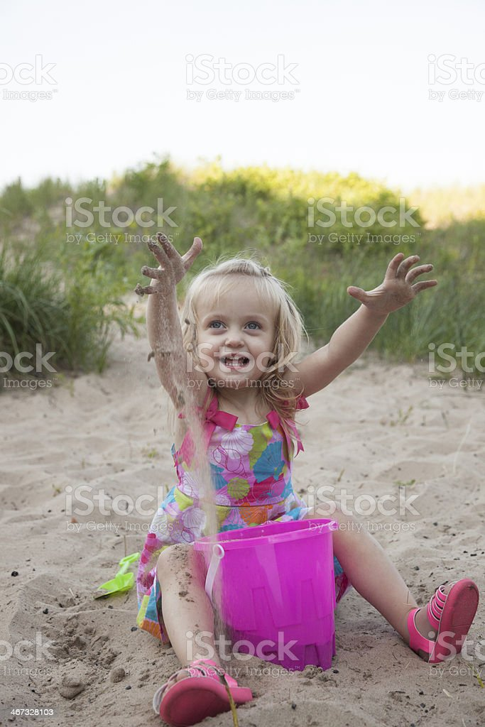 Laughing Blue Eyed Girl Looking up at camera on beach royalty-free stock photo