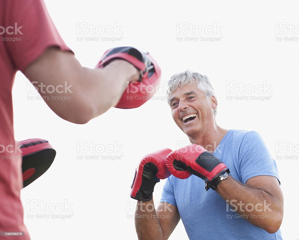Laughing boxer training with sparring partner royalty-free stock photo