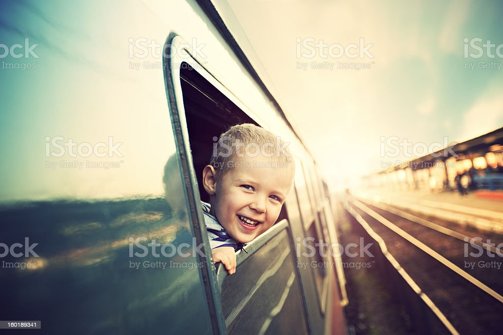 Laughing boy is going to train for a holiday stock photo