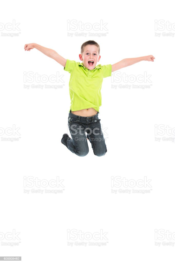 laughing boy jumping on white stock photo