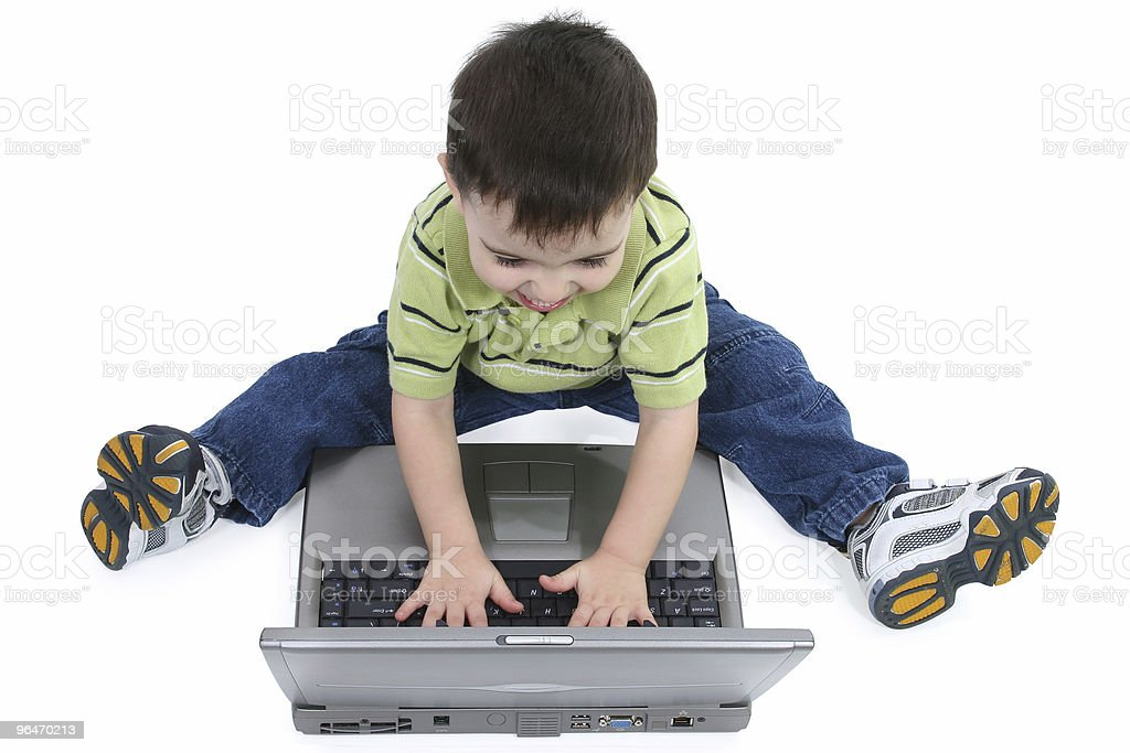 Laughing Boy on Laptop with Clipping Path royalty-free stock photo