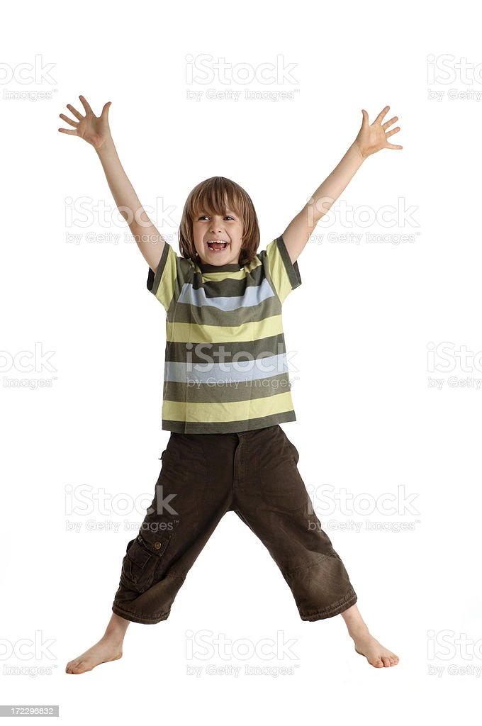Laughing boy standing with arms and legs spreaded stock photo