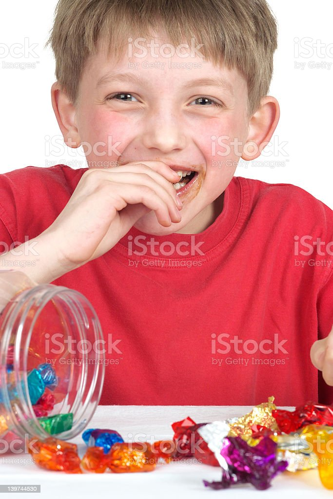 Laughing boy with candy, close cropped royalty-free stock photo