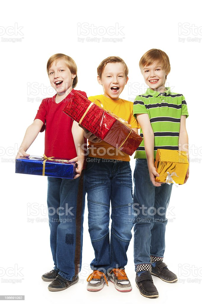 Laughing boys with presents royalty-free stock photo