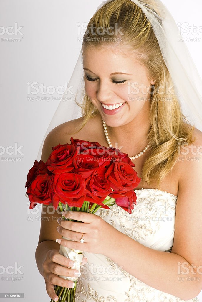 Laughing Bride with Her Roses royalty-free stock photo