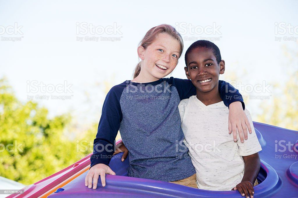 Laughing brothers embracing outside stock photo