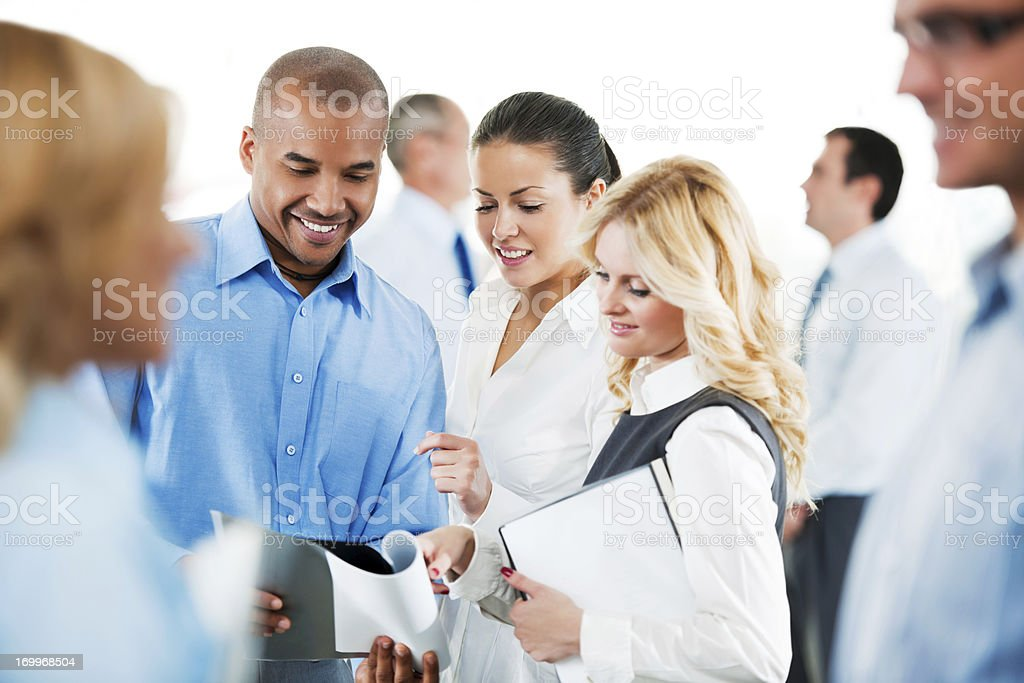 Laughing  businesspeople looking at reports. royalty-free stock photo