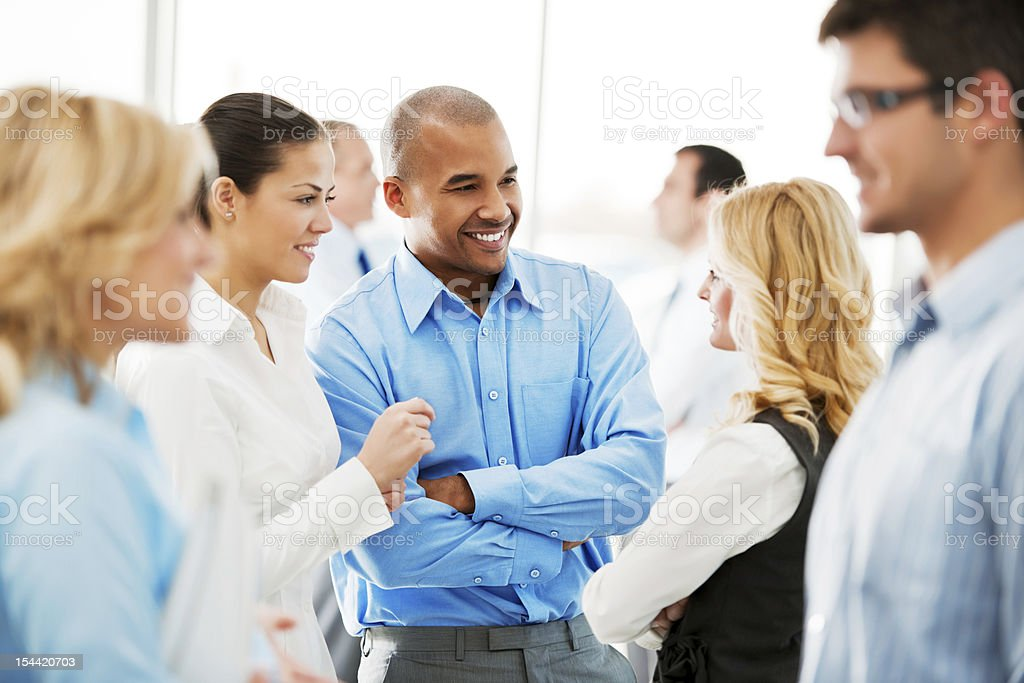 Laughing  businesspeople talking in the office. stock photo