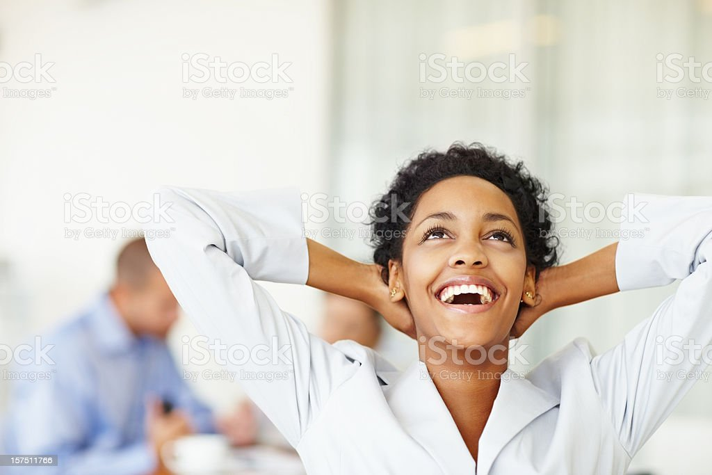 Laughing businesswoman with colleagues in the background royalty-free stock photo