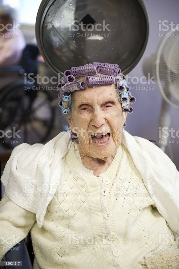Laughing Centenarian in Curlers royalty-free stock photo