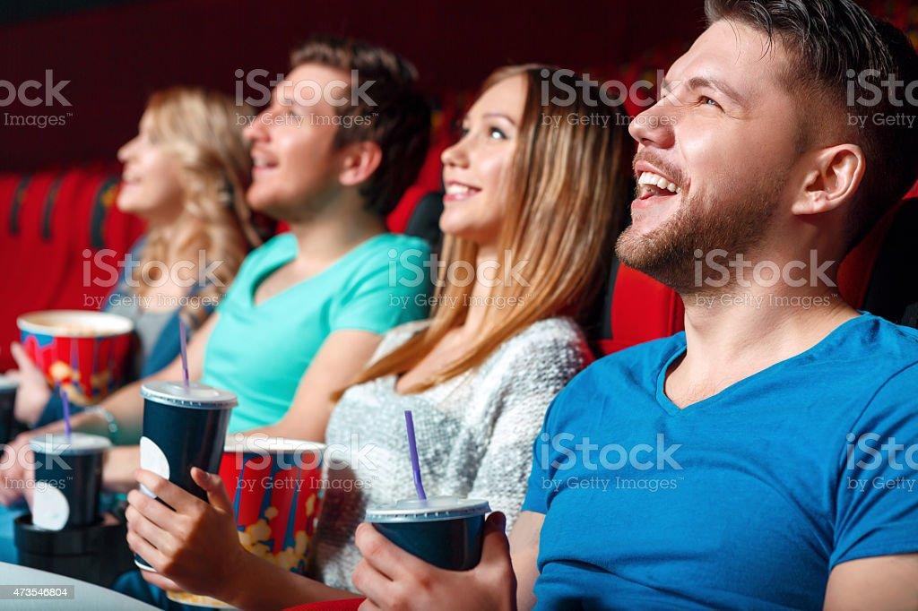 Laughing cinema visitor stock photo