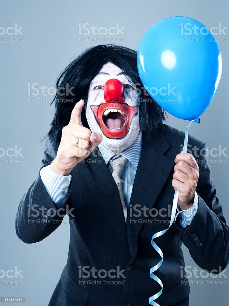 Laughing clown wearing a suit and tie royalty-free stock photo