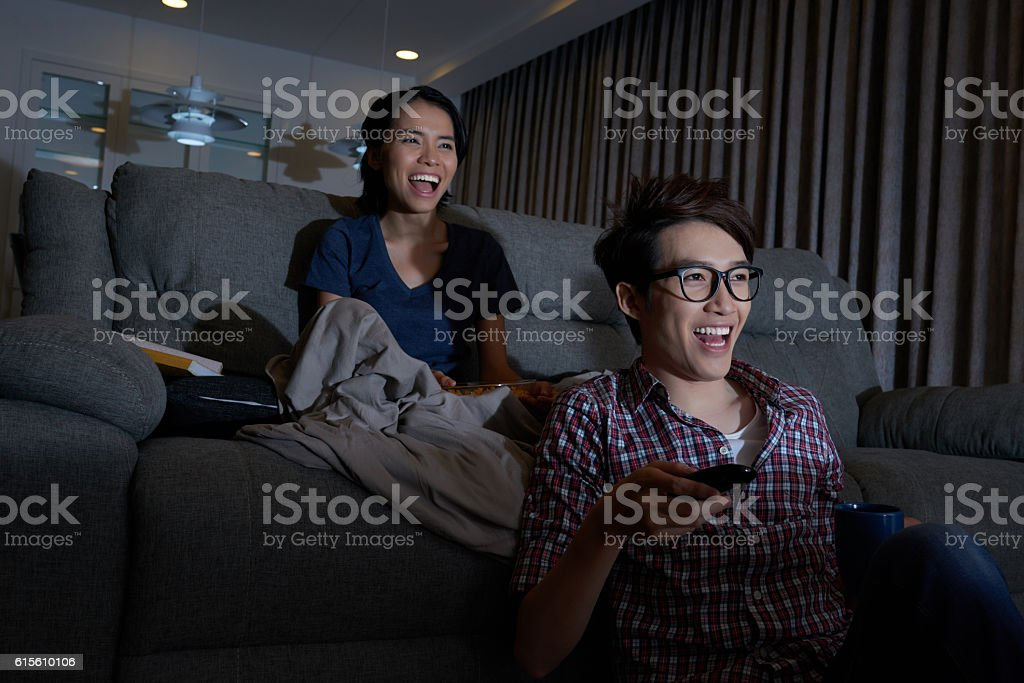 Laughing comedy watchers stock photo