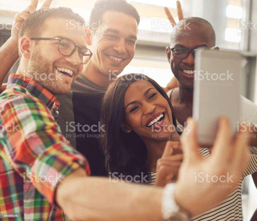 Laughing co-workers taking self portrait stock photo