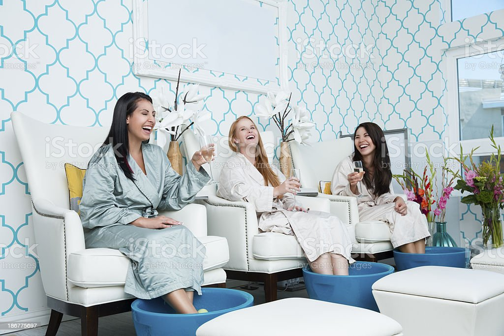 Laughing diverse girlfriends enjoying girls day out at the spa. You...