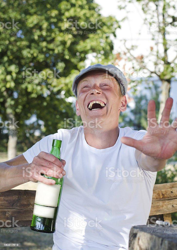 Laughing drunkard stock photo