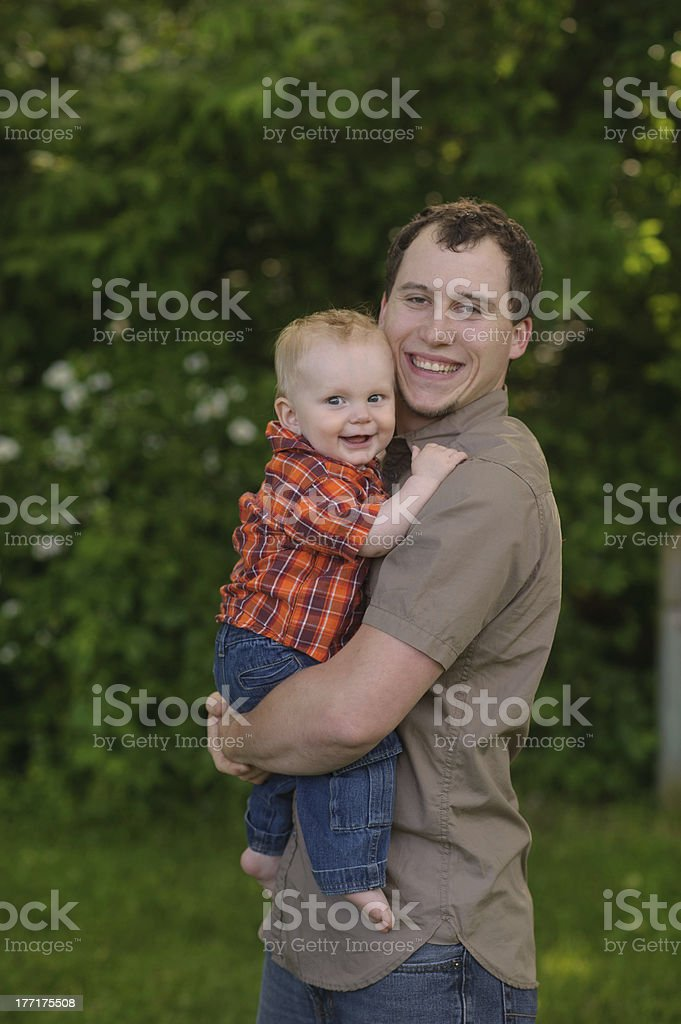 Laughing Father Holding His Son Outside royalty-free stock photo