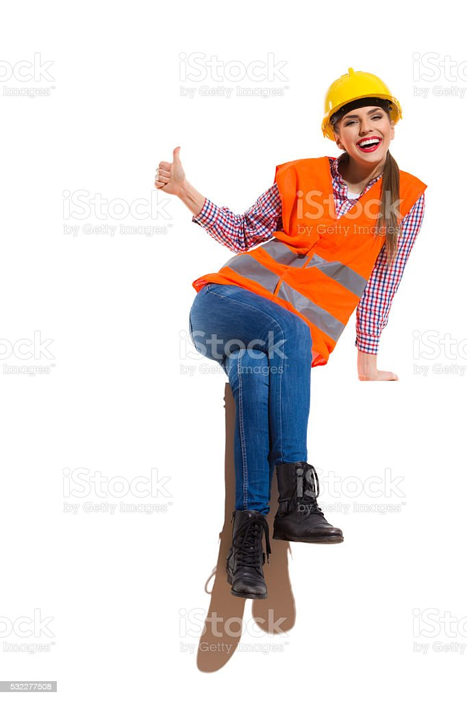 Laughing Female Construction Worker stock photo