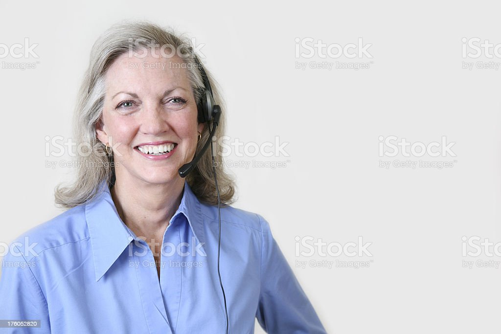 Laughing Female Customer Service Representative with Copy Space royalty-free stock photo