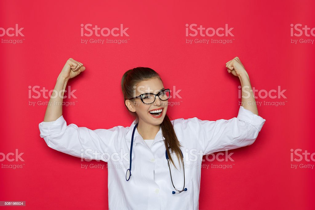 Laughing Female Doctor Cheering stock photo