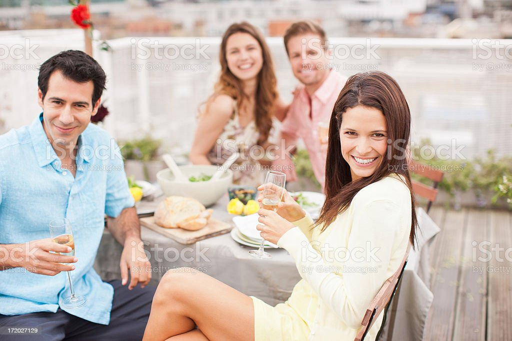 Laughing friends drinking Champagne at outdoor party royalty-free stock photo
