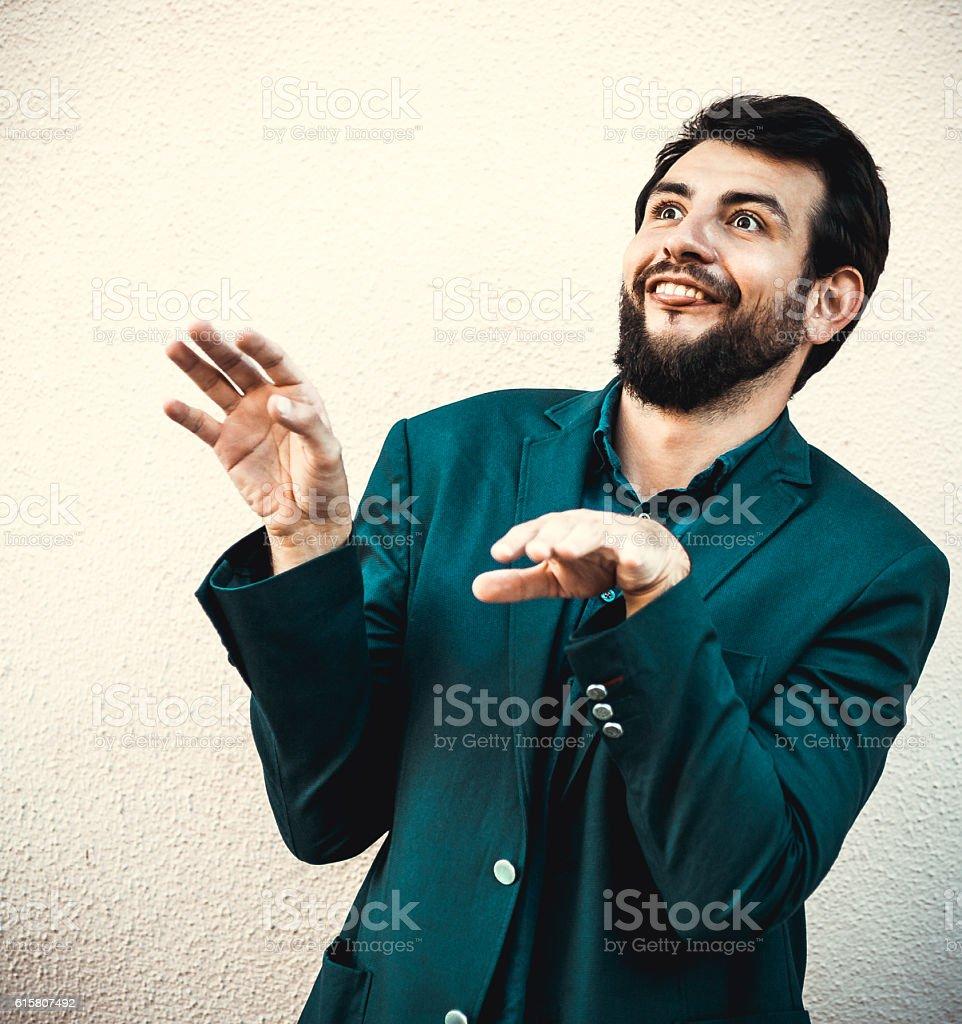 Laughing Funny businessman make grimace like ape stock photo