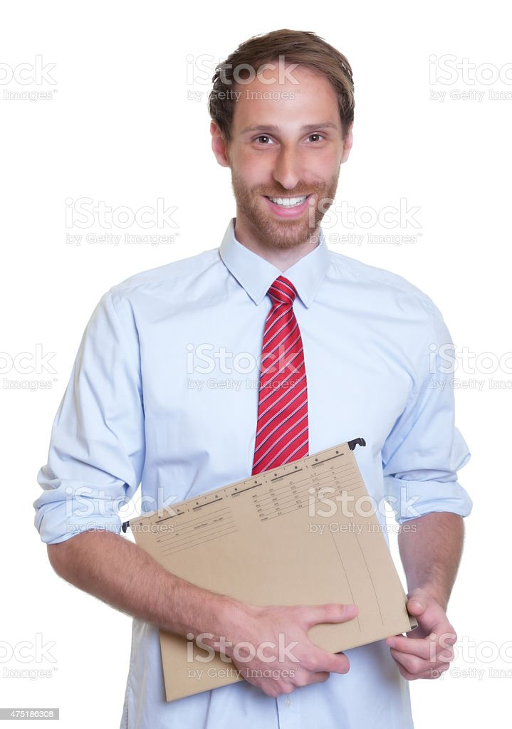 Laughing german businessman with file stock photo