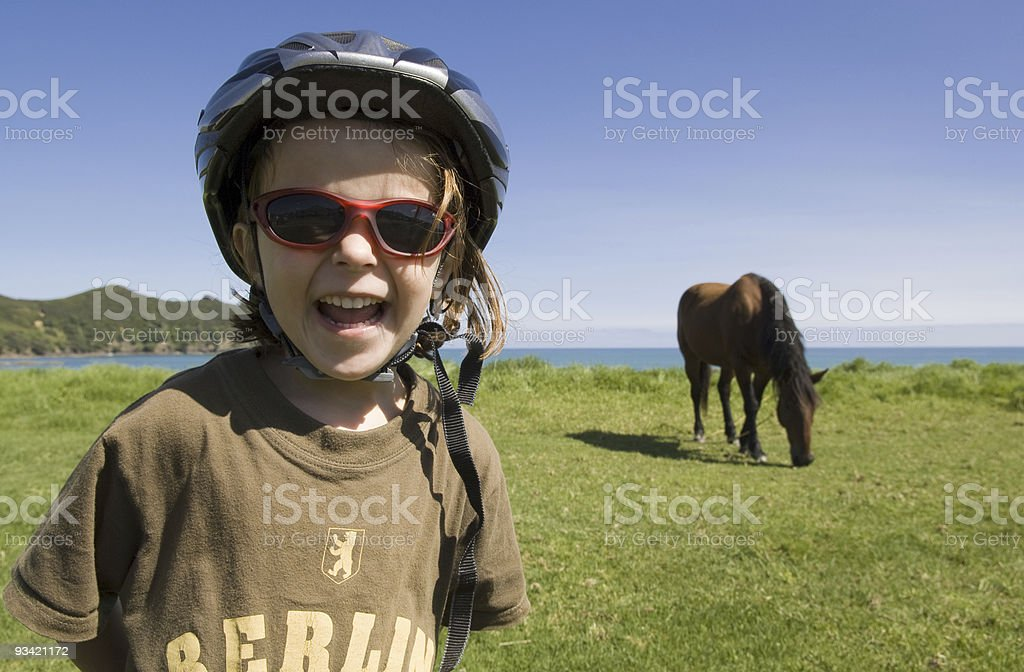 Laughing Girl and Horse royalty-free stock photo