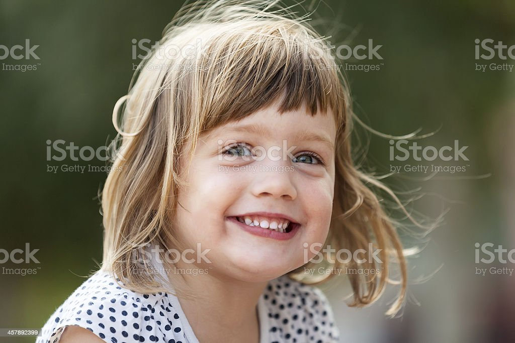 laughing  girl in summer park stock photo